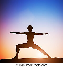 Woman in worrior yoga pose meditating at sunset. Zen