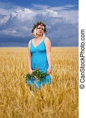 Woman in wreath of flowers