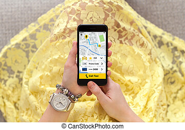 woman in yellow dress holding phone with application call taxi