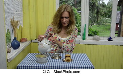 dried camomile tea - woman in yellow stained room enjoying...