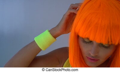 Woman in yellow swimsuit and orange wig