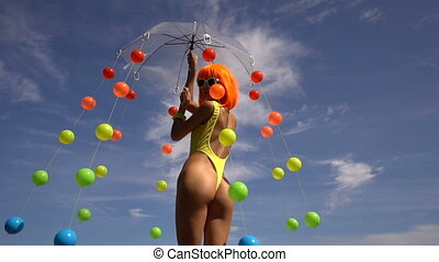 Woman in yellow swimsuit and orange wig - Sexy beautiful...