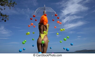 Woman in yellow swimsuit and orange wig - Back view of sexy...