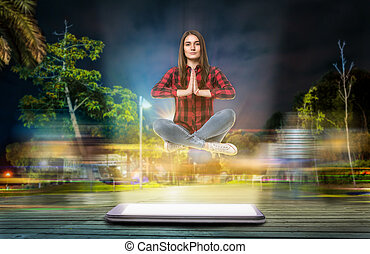 Woman in yoga pose hovers above a big phone