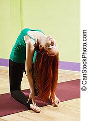 Woman inclined backwards