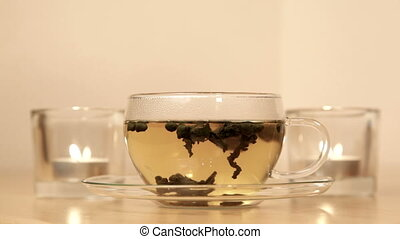 Woman inhales aroma of green tea
