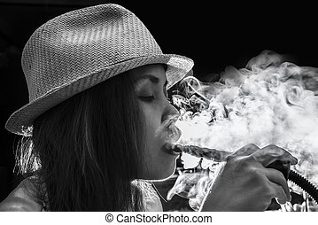 Woman Inhaling from a Hookah