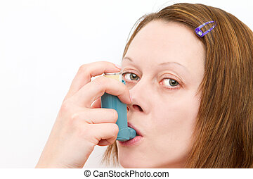 woman inhaling her asthma pump