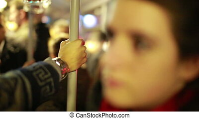 Woman inside crowded metro