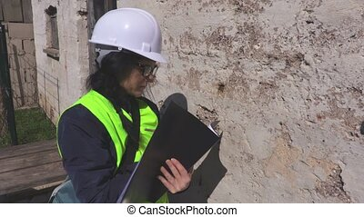 Woman inspect the old wall