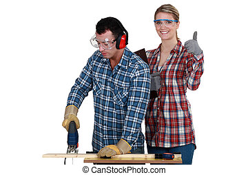 Woman inspecting carpenter