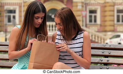 Woman inspecting content of paper bags with fresh buyings....