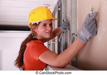 Woman installing wiring