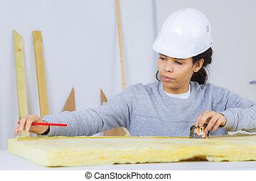 woman insulation installer