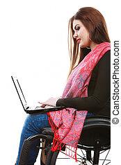 Woman invalid girl on wheelchair using computer