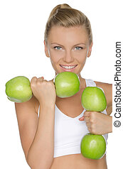 woman involved in fitness dumbbells of apples - woman...