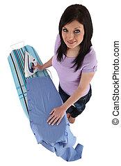 woman ironing male's shirt