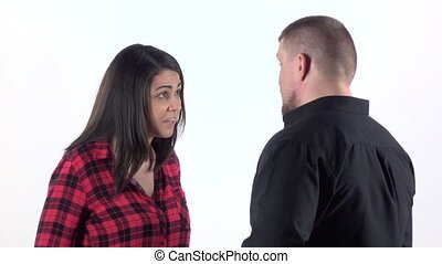 Woman is arguing with her man and slaps him. Close up. Slow motion