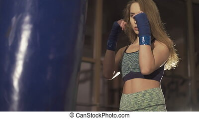 Woman is boxing in gym