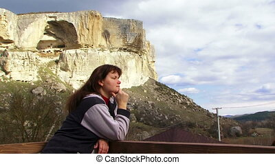 Woman is breathing the mountain air