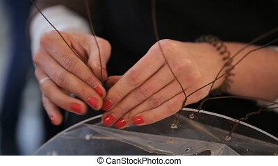Woman is creating handmade composition. Preparing flower art...