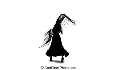 Woman is dancing with a manton in her hands. White background. Silhouette