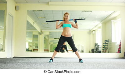 Woman is doing exercises with Body