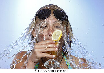 water shower - woman is drinking and gets a water shower