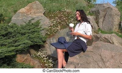 Woman is drinking tea.