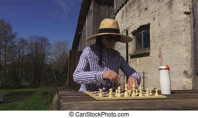 Woman is going to play the chess