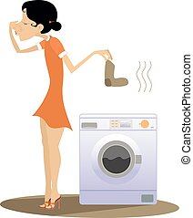 Young woman stands near washing machine holds her nose from dirty laundry odor nuisance isolated on white