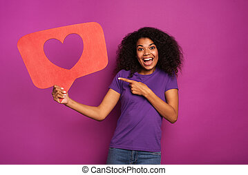 Woman is happy because receives hearts on social network