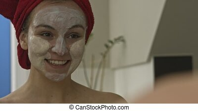 Woman is having face mask - The movie with young woman...