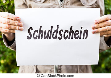 Woman is holding a burning paper with german word
