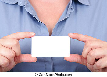 woman is holding a business card