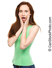 Woman is holding her face in astonishment - Young woman is ...