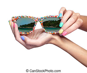 Woman is holding sunglasses with sea beach reflection isolated on white background