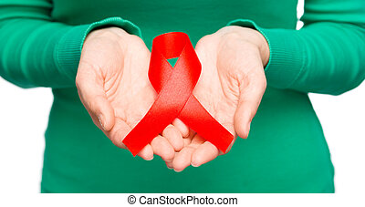 Woman is holding the red awareness ribbon