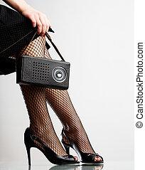 woman is holding the retro radio