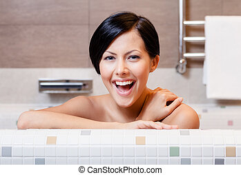 Woman is in bathtub