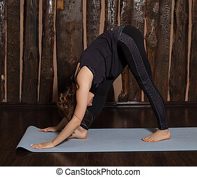 Woman is in intense side stretch pose