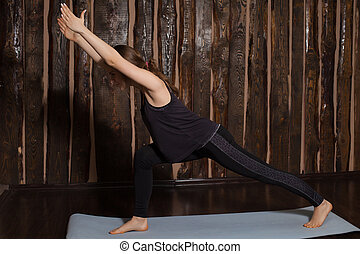 Woman is in lange pose - Young and cute woman is doing lange...