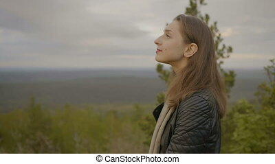 Woman is looking on the sky