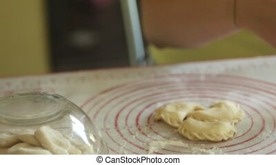 woman is making from dough dumplings 4K close-up