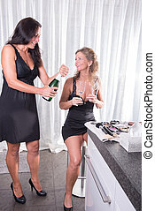 woman is opening a bottle of champagne