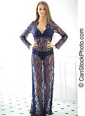 Woman is posing in a dress