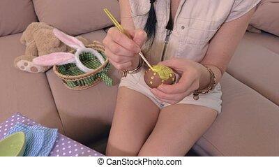 Woman is preparing Easter eggs