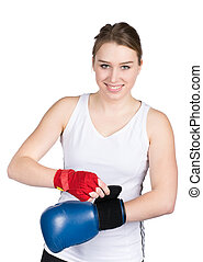Woman is putting on boxing glove