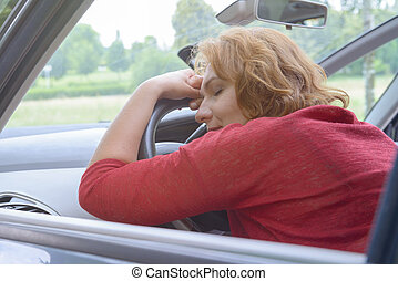 Woman is resting in the car