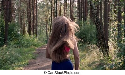 Woman is running in the forest
